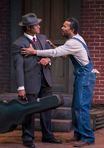 Hedley (Allen Gilmore) sees danger beyond the backyard fence for Floyd (Kelvin Roston, Jr.) in 'Seven Guitars' at Court Theatre. (Michael Brosilow)