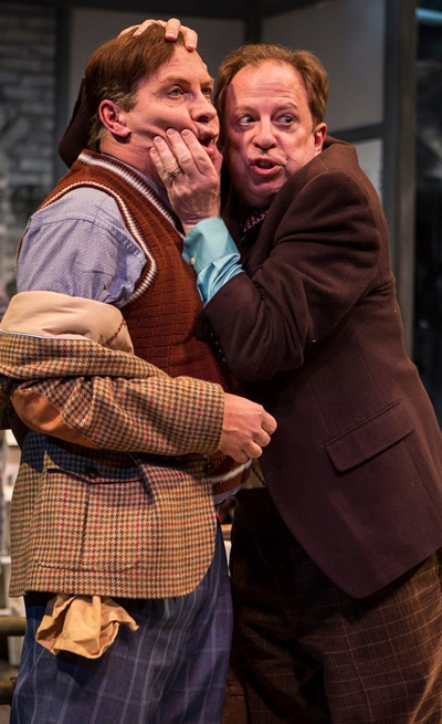 Jealous Master Ford (Ross Lehman, right) fervently warns Master Page (Kevin Gudahl) about the lecherous Falstaff. (Liz Lauren)