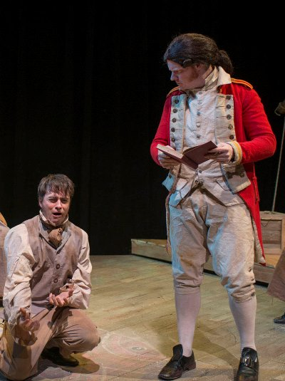 The stage director (Stephen Peebles) pleads for a bit less emotion from an eager inmate (Kevin Viol) in 'Our Country's Good.' (Michael Brosilow)