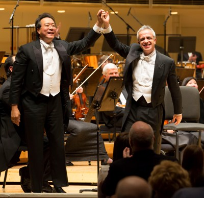Yo-Yo Ma and Giovanni Sollima take a bow after the world premiere of Sollima's 'Antidotum Tarantulae XXI' double cello concerto, which he wrote for the Chicago Symphony. (Todd Rosenberg)