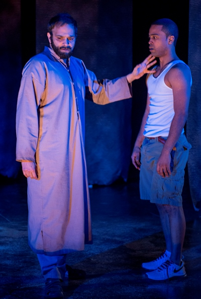 Elliot (Edgar Miguel Sanchez, right) confronts a spectral figure (Anish Jethmalani) in 'Water by the Spoonful.' (Michael Brosilow)