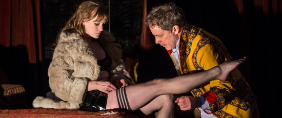Vanda (Amanda Drinkall) gets a little help with her stockings from Thomas (Rufus Collins) in 'Venus in Fur' at Goodman Theatre. (Liz Lauren)