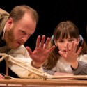 Darwin (Andrew White) shows his children (Caroline Heffernan and John Francis Babbo) the hand-like bones common to various creatures. (Liz Lauren)