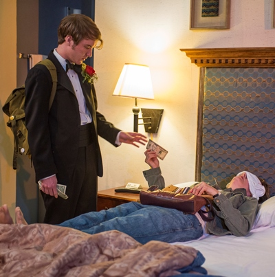 Jonathan (Matt Farabee) collects his marijuana payment from recumbent, unseeing Beth in 'Mud Blue Sky.' (Michael Brosilow)