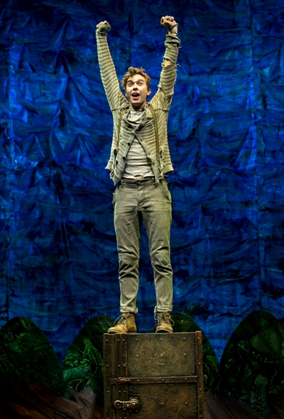 Peter (Joey deBettencourt) revels in his freedom as he guards a special trunk in 'Peter and the Starcatcher.' (Terry Shapiro)