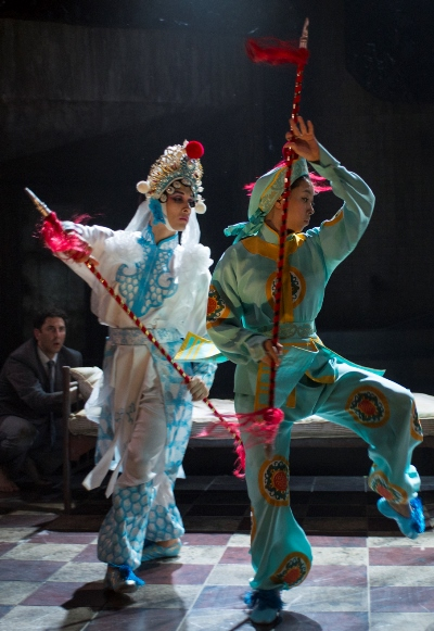 Dancers perform stylized combat in 'M. Butterfly' at Court Theatre. (Michael Brosilow)