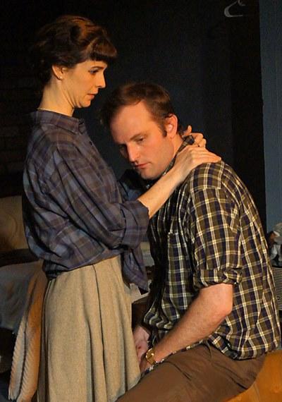 Helena (Lucy Carapetyan) offers solace to Jimmy (Joseph Wiens) in 'Look Back in Anger.' (Jan Ellen Graves)