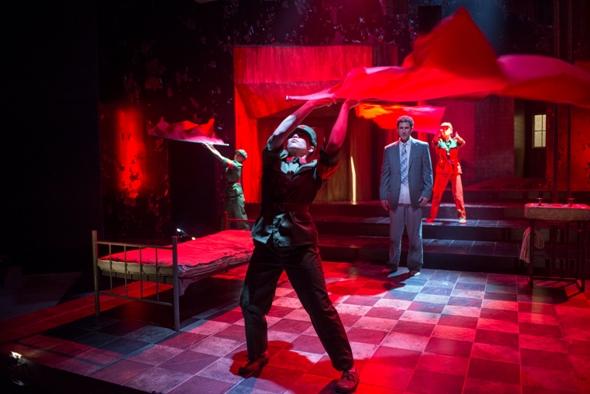 Kurogo dancers enact Cultural Revolution zeal before Galliard (Sean Fortunato) in 'M. Butterfly.' (Michael Brosilow)
