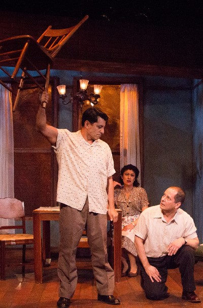 Marco (Eddie Diaz, left) flexes muscle to make a dark point to Eddie (Ramon Camin). (Joel Maisonet)