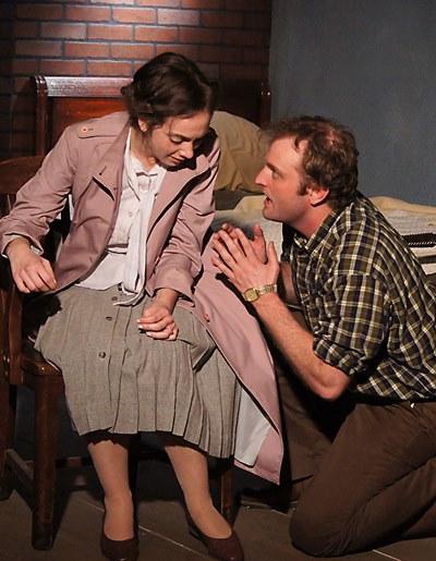 Jimmy (Joseph Wiens) consoles his grief-stricken wife Alison (Baize Buzan) in 'Look Back in Anger.' (Jan Ellen Graves)