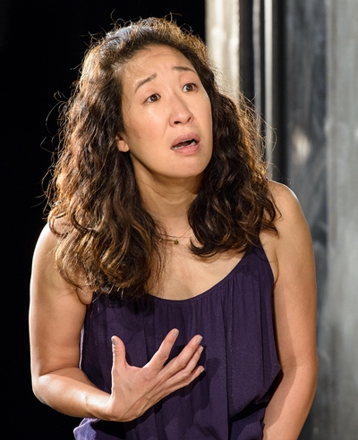 Paulina (Sandra Oh) pleads with her husband to believe that the strange man in their home is her former tormentor. (Michael Courier)
