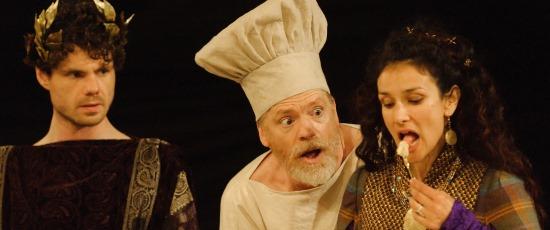 Saturninus (Matthew Needham, left) looks on as Titus (William Houston) serves up a special delicacy to Goth Queen Tamora (Indira Varma). (Simon Kane)