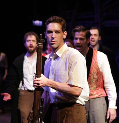 Lee Harvey Oswald (Nathan Gardner) hears his progenitors urge action in Dallas in 'Assassins' by Sondheim and Weidman for Kokandy Productions (Joshua Albanese).