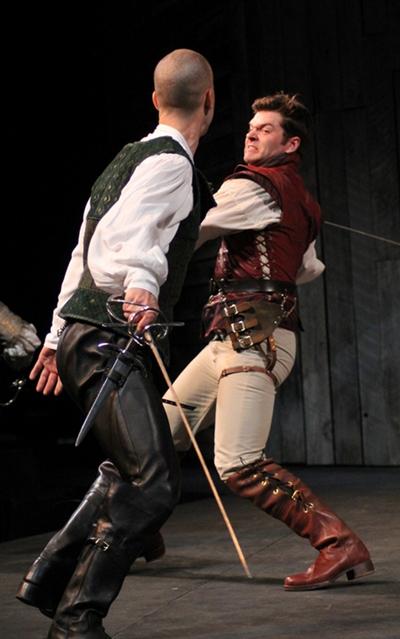Tybalt (Eric Parks, left) and Mercutio lay on in the public square. (Carissa Dixon)