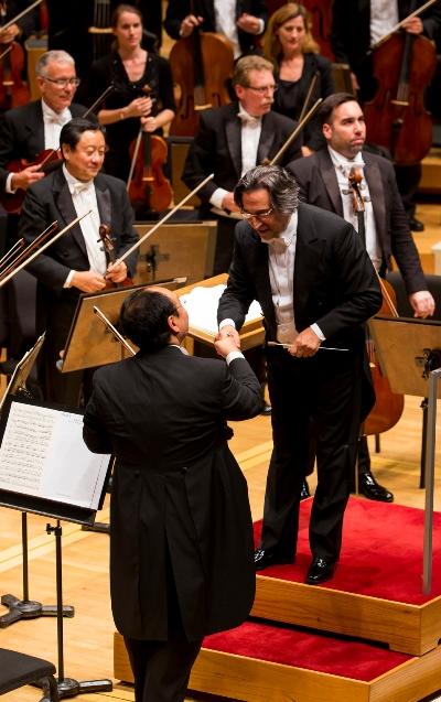 Chicago Symphony music director Riccardo Muti and concertmaster Robert Chen share a congratulatory moment. (Todd Rosenberg)