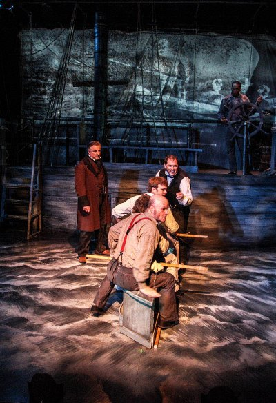Ill-fated whale hunters bear down on their quarry in the tale of the Essex bold by narrator Ben Werling (rear left). (Emily Schwartz)