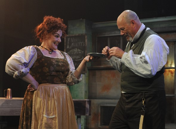 An inspired Mrs. Lovett (Rebecca Finnegan) invites Sweeney Todd (David Girolmo) to try a meat pie made of priest. (Brandon Dahlquist)