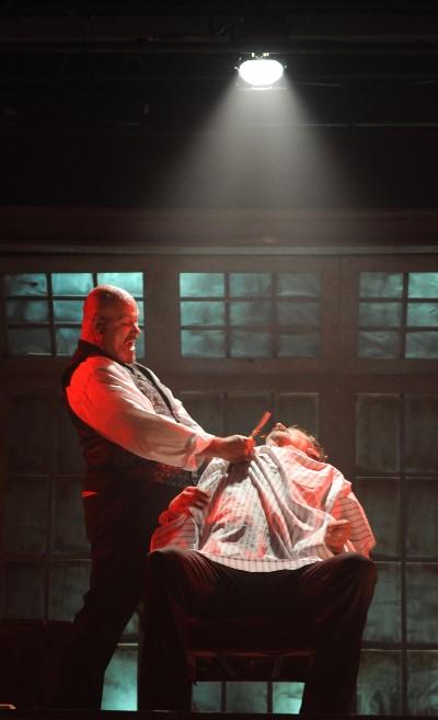 Sweeney Todd (David Girolmo) unleashes his razor on unsuspecting customers. (Brandon Dahlquist)