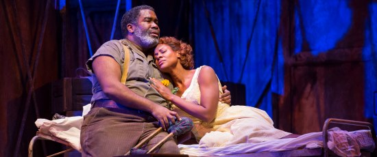 Porgy (Eric Owens) comforts Bess (Adina Aaron) in Gershwin's 'Porgy and Bess.' (Todd Rosenberg)