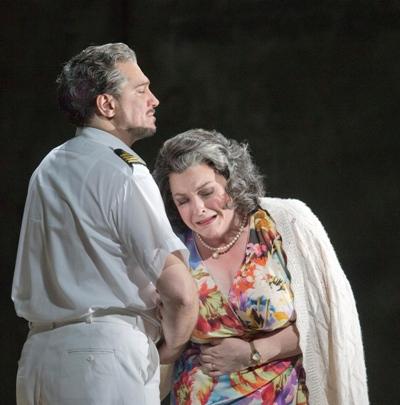 The ship's captain (Paulo Szot) tells Marilyn Klinghoffer (Michaela Martens) that her husband is dead. Metropolitan Opera 2014. (Ken Howard)