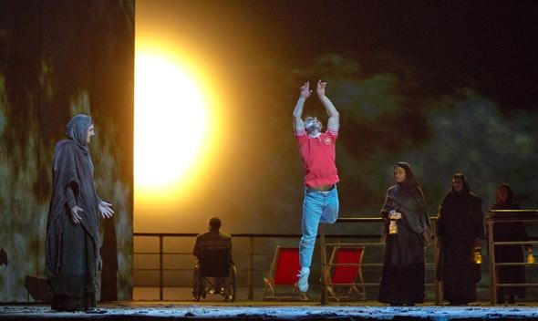 Young Omar (dancer Jesse Kovarsky) is inspired to seek a martyr's Paradise. Metropolitan Opera 2014. (Ken Howard)