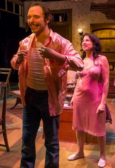 Alvaro (Nic Grelli) tries on a pink silk shirt on loan from Serafina (Eileen Niccolai). (Michael Brosilow)