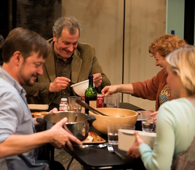Before the shoe drops, a happy time at the Thanksgiving table for Brigid (Kelly O'Sullivan, right), boyfriend Richard (Lance Baker, left), Erik (Keith Kupferer), Deirdre (Hanna Dworkin). (Michael Brosilow)