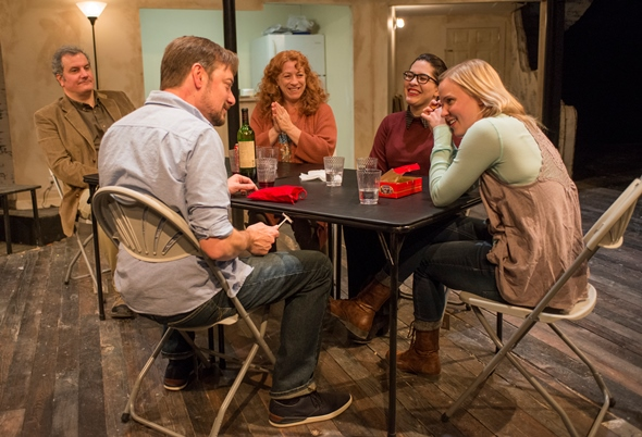Boyfriend Richard (Lance Baker, foreground) learns a family tradition from the Blakes, from left, Erik (Keith Kupferer), Deirdre (Hanna Dworkin), Aimee (Sadieh Rifai) and Brigid (Kelly O'Sullivan). (Michael Brosilow)