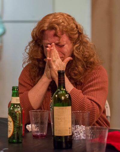 Deirdre Blake (Hanna Dworkin) knows the bad news her husband is about share with their daughters in 'The Humans.' (Michael Brosilow)