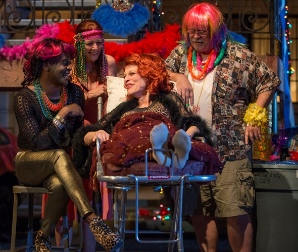 Reveling in her own funeral celebration, Miss Ruby (Judith Roberts) is surrounded by Humming Bird veterans, from left, Sissy Na Na (K. Todd Freeman), Tanya (Kate Buddeke) and Wayne (Scott Jaeck). (Michael Brosilow)