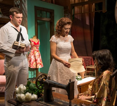 Sailor Jack Hunter (Drew Schad) lends moral support as Rosa (Daniela Colucci) shows her high school diploma to her mother Serafina (Eileen Niccolai). (Michael Brosilow)