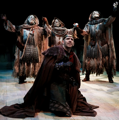 The three weird sisters tantalize Macbeth (Chris Genebach) with their ambiguous foretelling of kingship. (Liz Lauren)