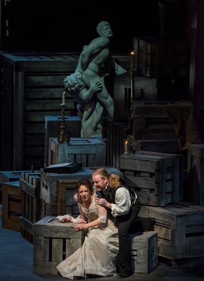 Trapped in an isolated storeroom, Tosca (Tatiana Serjan) resists lustful Scarpia (Yevgeny Nikitin). (Todd Rosenberg)