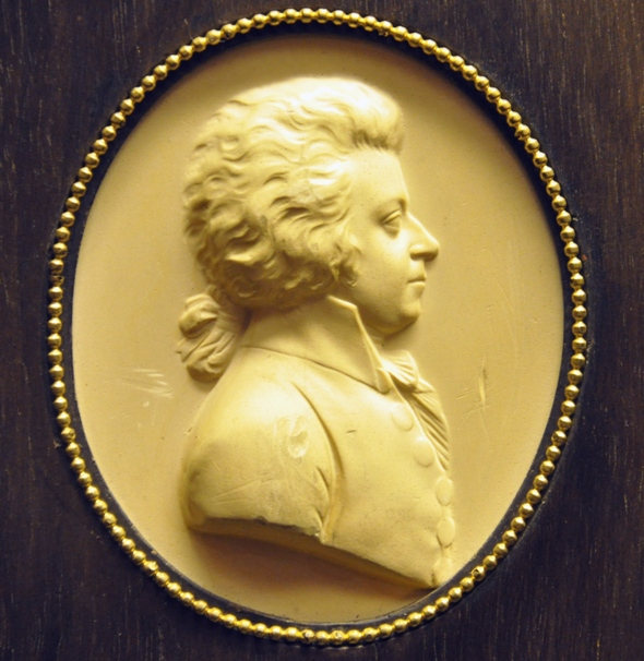 Mozart by Leonard Posch, 1788-89, detail from plaster relief of wood carving (Wien Kunsthistorisches Museum via Wiki Commons)