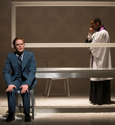 Connor (Alex Weisman) makes a complicated confession to his priest (Allen Gilmore). (Michael Brosilow)