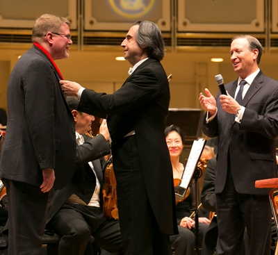 Retired CSO principal bassoonist David McGill received the Theodore Thomas Medallion from music director Riccardo Muti and CSO preside