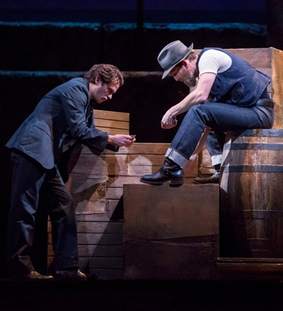Billy Bigelow (Steven Pasquale) is easily led further astray by Jigger (Jarrod Emick) in Lyric Opera of Chicago's 'Carousel.' (Todd Rosenberg)