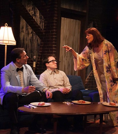 Drunk and angry, Terry (Kate Buddeke) rails at husband Gene (Michael Ehlers) and son Clifford (Michael Mahler). (Johnny Knight)