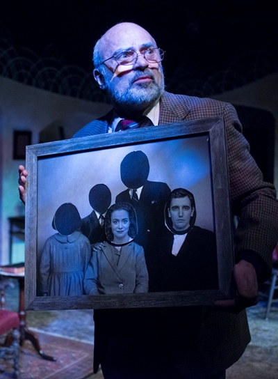 The Gentleman narrator (Ron Quade) gives the audience a close look at Tomasian's macabre family photo. (Dean LaPrairie)