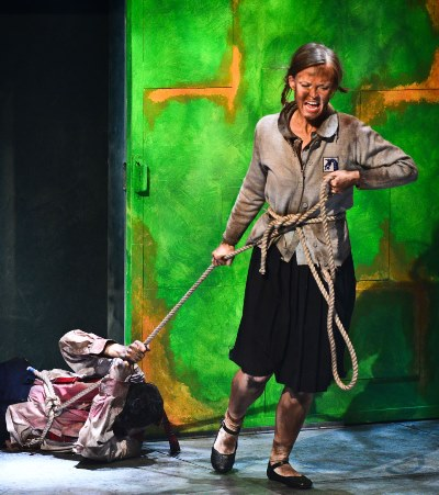 Antigone (Erin Barlow) drags her disgraced and self-blinded father Oedipus (John Taflan). (Evan Hanover)