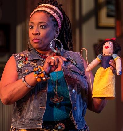 Cassandra (E. Faye Butler) works a bit of voodoo on a Snow White effigy of Masha. (Liz Lauren)