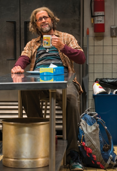 Frog (Tim Hopper) makes himself at home in the soup kitchen. (Michael Brosilow)