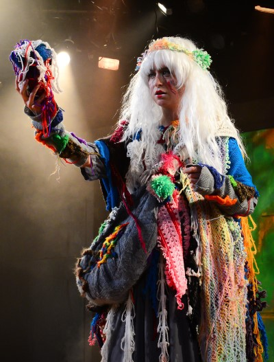 The visionary Cassandra (Christine Stulik) knits hearts as auguries for those about to die. (Evan Hanover)