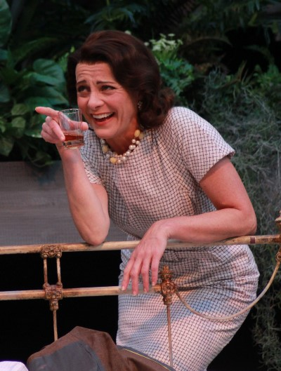 Blanche (Tracy Michelle Arnold) enjoys a drink and a laugh during a peaceful moment in her stay with her sister Stella (Carissa Dixon)