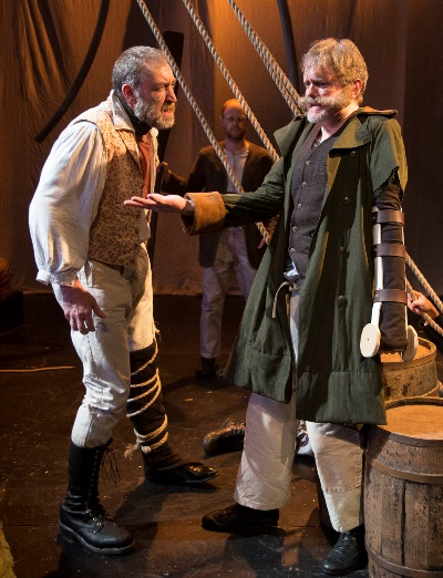 Hearing another sea captain (Raymond Fox, right) describe a calamitous encounter with Moby Dick, Captain Ahab (Christopher Donahue) wants only to know where to look for the whale. (Liz Lauren)