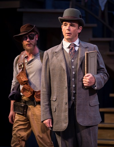 Master Ford (David Daniel) resorts to trickery in hope of trapping his wife with Falstaff, whose pal Pistol (Jeb Burris) observes. (Liz Lauren)
