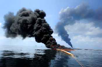 U.S. Coast Guard and BP set a fire to attempt control of spreading oil after the April 2010 explosion of the BP Horizon. (Defense.gov)