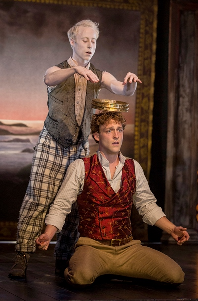 Ariel (Nate Dendy) magically suspends the crown of Naples over the head of Ferdinand (Luigi Sottile). (Liz Lauren)