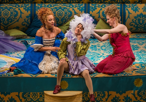 Cherubino (Rachel Frenkel, center) resists as Susanna (Christiane Karg) and the Countess (Amanda Majeski) dress him as a girl. (Todd Rosenberg)