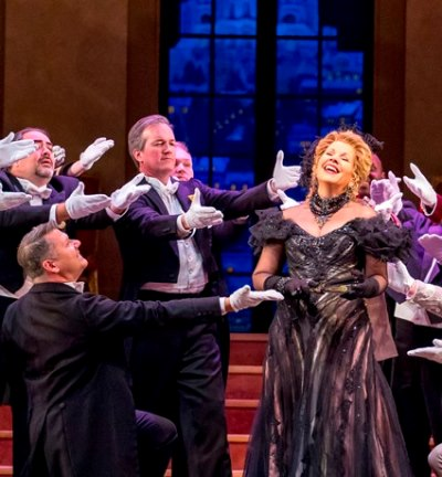 The wealthy (and merry) widow Hanna Glawari (Renée Fleming) is the toast of a grand ball. (Todd Rosenberg)
